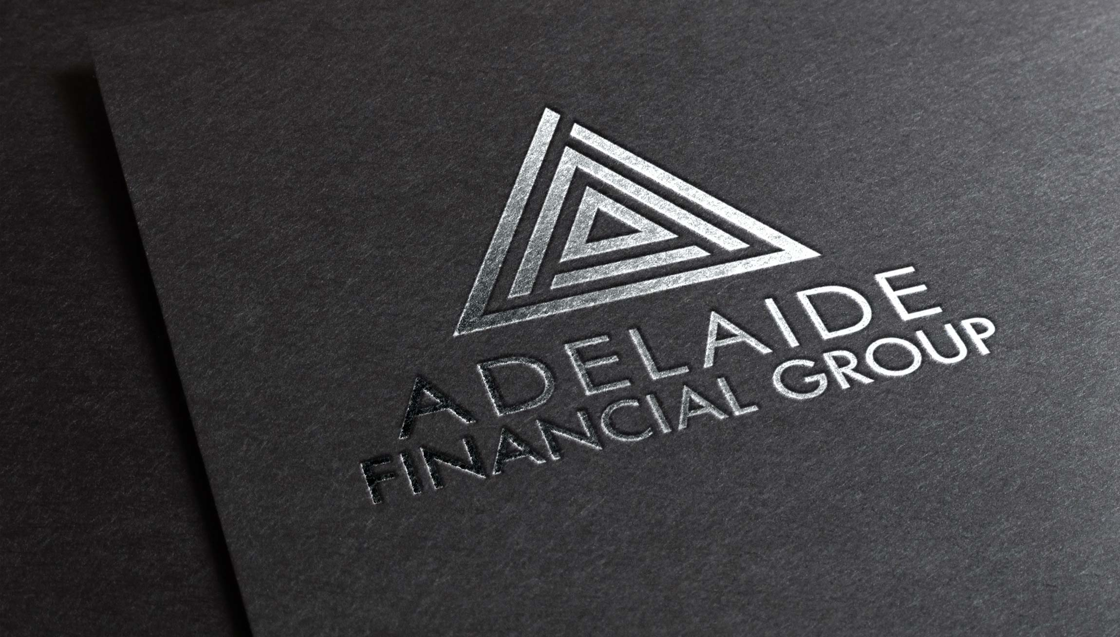 Logo & Branding - Logo design mockup on a black card with silver metallic printing for Adelaide Financial Group