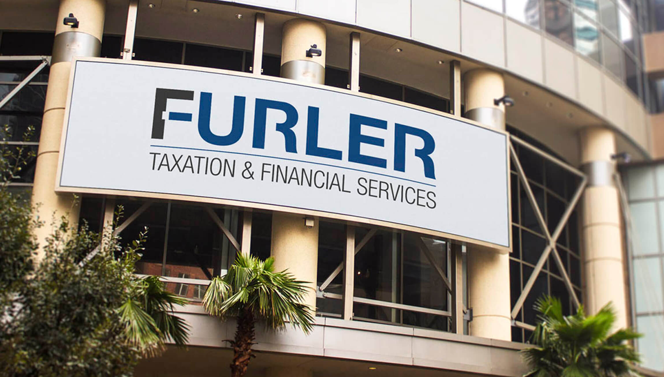 Logo & Branding - Logo design mockup on a large office sign for Furler Financial and Taxation Services