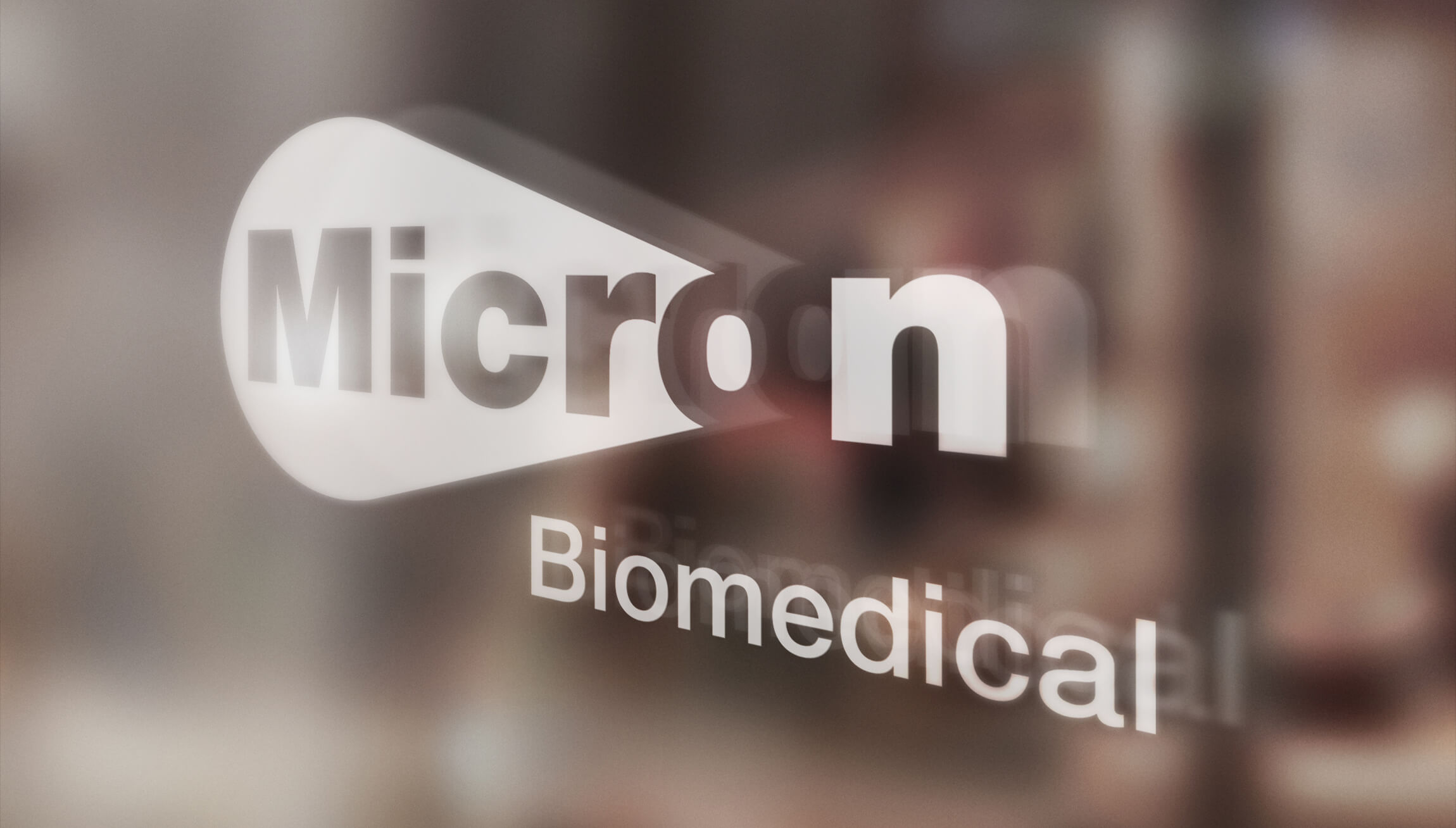 Logo & Branding - Logo design mockup on glass at an office for Micron Biomedical